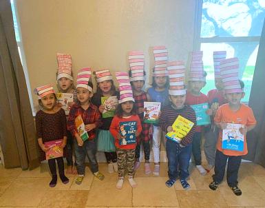 kids wearing hats singing